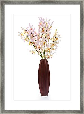 Pink Orchid In Wood Vase Framed Print by Atiketta Sangasaeng