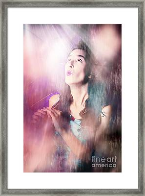 Pinup Woman Mesmerised By Pouring Down Rainfall Framed Print by Jorgo Photography - Wall Art Gallery