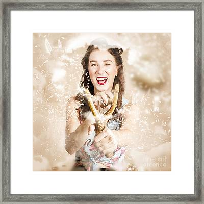 Pinup Woman Shooting Rocks With Toy Slingshot Framed Print by Jorgo Photography - Wall Art Gallery