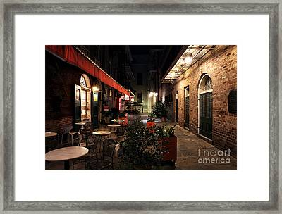 Pirates Alley At Night Framed Print by John Rizzuto