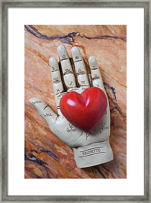 Plam Reader Hand Holding Red Stone Heart Framed Print by Garry Gay