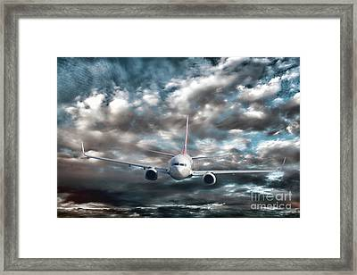 Plane In Storm Framed Print by Olivier Le Queinec