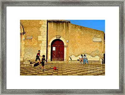 Playing In Taormina Framed Print by Silvia Ganora