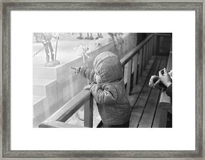 Pointing The Dream Out Framed Print by Philippe Taka