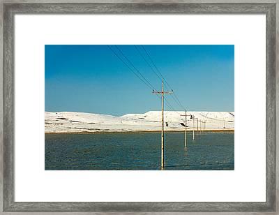 Poles Submerged Framed Print by Todd Klassy