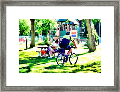 Police Officer Rides A Bicycle Framed Print by Lanjee Chee
