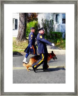 Policeman And Dog In Parade Framed Print by Susan Savad