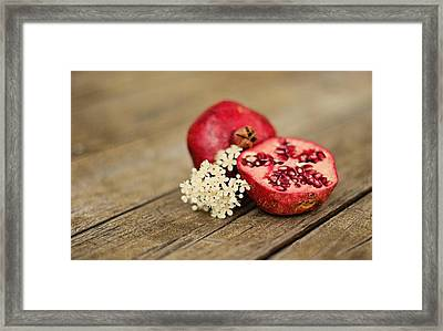 Pomegranate And Flowers On Tabletop Framed Print by Anna Hwatz Photography Find Me On Facebook