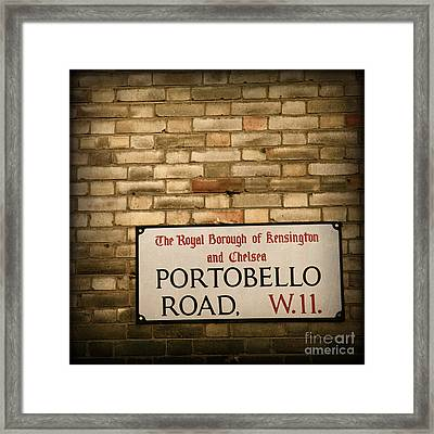 Portobello Road Sign On A Grunge Brick Wall In London England Framed Print by ELITE IMAGE photography By Chad McDermott
