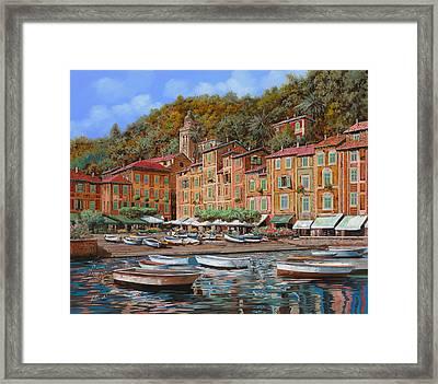 Portofino-la Piazzetta E Le Barche Framed Print by Guido Borelli