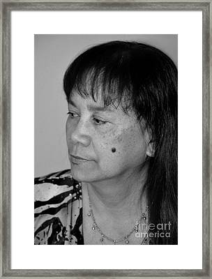 Portrait Of An Attractive Filipina Woman With A Mole On Her Cheek Framed Print by Jim Fitzpatrick