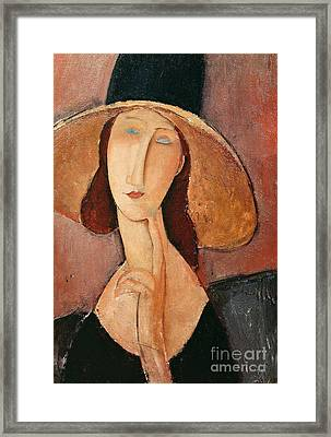 Portrait Of Jeanne Hebuterne In A Large Hat Framed Print by Amedeo Modigliani