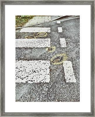 Potholes In A Road Framed Print by Tom Gowanlock