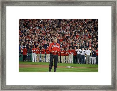 President George W. Bush Throws Framed Print by Everett