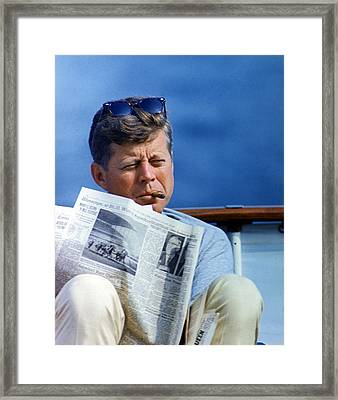 President John Kennedy Smoking A Cigar Framed Print by Everett