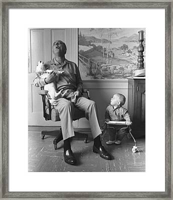 President Lyndon Johnson Sings With Dog Framed Print by Everett