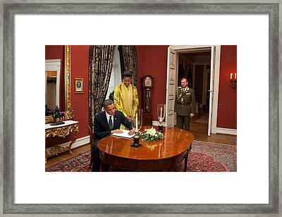 President Obama And Michelle Obama Sign Framed Print by Everett