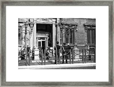 Protecting Rome Framed Print by John Rizzuto