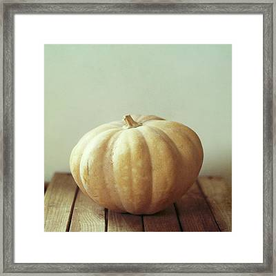 Pumpkin On Wooden Table Framed Print by Copyright Anna Nemoy(Xaomena)