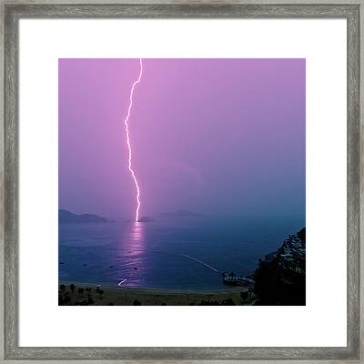 Purple Glow Of Lightning Framed Print by Judi Mowlem