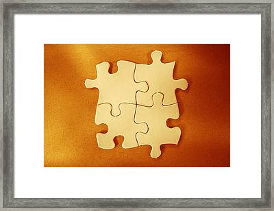 Puzzle Pieces  Framed Print by Les Cunliffe