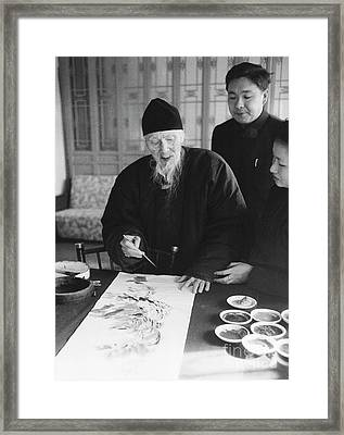 Qi Baishi At Work In His Studio, January 1957. Framed Print by The Phillip Harrington Collection