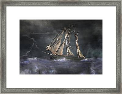 Racing The Storm Framed Print by Carol and Mike Werner