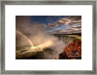 Rainbows Over Niagara Falls  Framed Print by Rob Hawkins