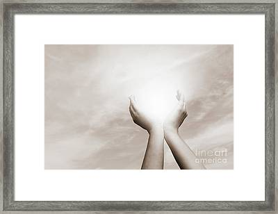 Raised Hands Catching Sun On Cloudy Sky. Concept Of Spirituality, Wellbeing, Positive Energy Framed Print by Michal Bednarek