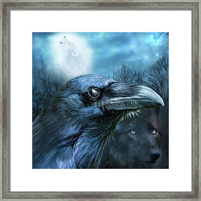 Raven And Wolf - In The Moonlight Framed Print by Carol Cavalaris