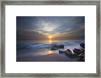 Rays On The Waves Framed Print by Debra and Dave Vanderlaan