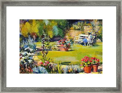 Reading In The Garden Framed Print by Sue Wales