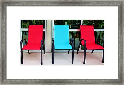 Red And Blue Chairs Framed Print by Cynthia Guinn