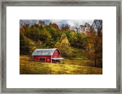 Red Barn In Autumn Framed Print by Debra and Dave Vanderlaan