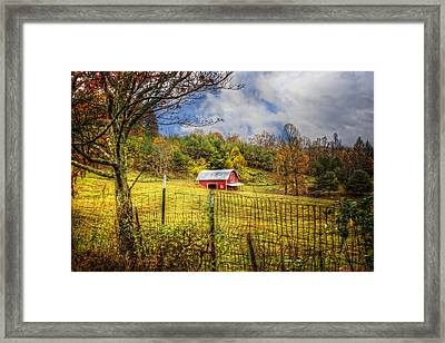 Red Barn In The Pasture Framed Print by Debra and Dave Vanderlaan