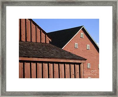 Red Barns And Blue Sky With Digital Effects Framed Print by William Kuta