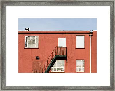 Red Building Framed Print by Tom Gowanlock