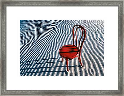 Red Chair In Sand Framed Print by Garry Gay