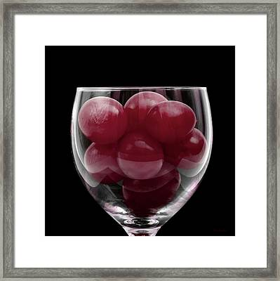 Red Grapes In Glass Framed Print by Wim Lanclus