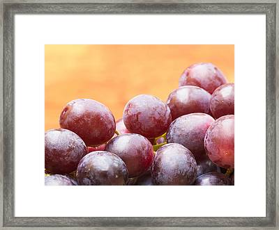 Red Grapes Framed Print by Wim Lanclus