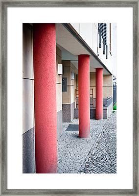 Red Pillars Framed Print by Tom Gowanlock