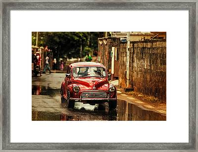 Red Retromobile. Morris Minor Framed Print by Jenny Rainbow