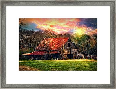 Red Roof At Sunset Framed Print by Debra and Dave Vanderlaan