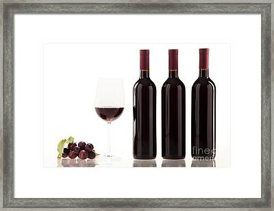 Red Wine In Glass With Fruit Leaves And Wine Bottle Framed Print by Wolfgang Steiner
