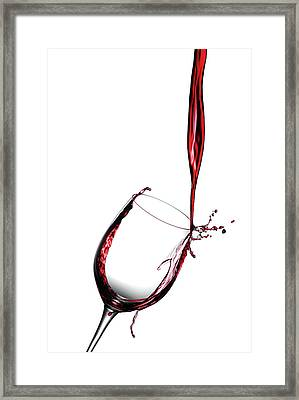 Red Wine Pouring Into Wine Glass Framed Print by Joseph LaPlaca
