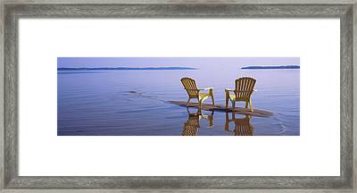 Reflection Of Two Adirondack Chairs Framed Print by Panoramic Images