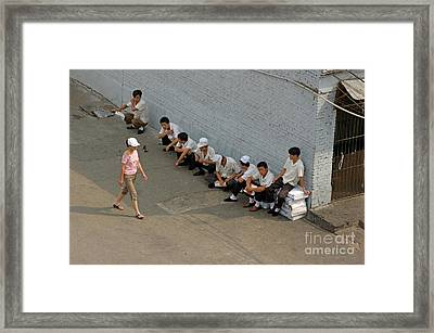 Restaurant Workers Having A Break Outside As A Woman Walks Past Framed Print by Sami Sarkis