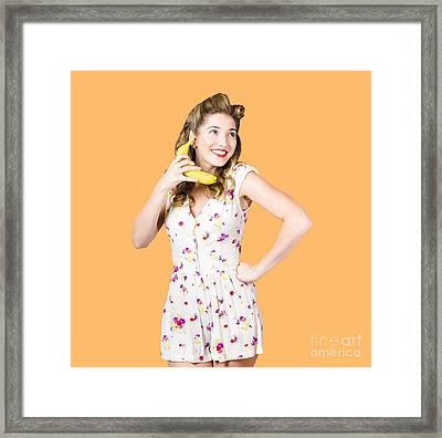 Retro Pin Up Girl Chatting On Banana Telephone Framed Print by Jorgo Photography - Wall Art Gallery