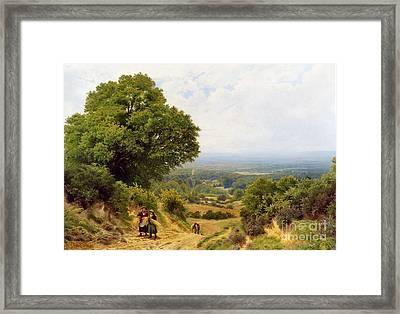 Returning From The Harvest Framed Print by John Clayton