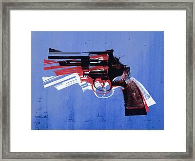 Revolver On Blue Framed Print by Michael Tompsett
